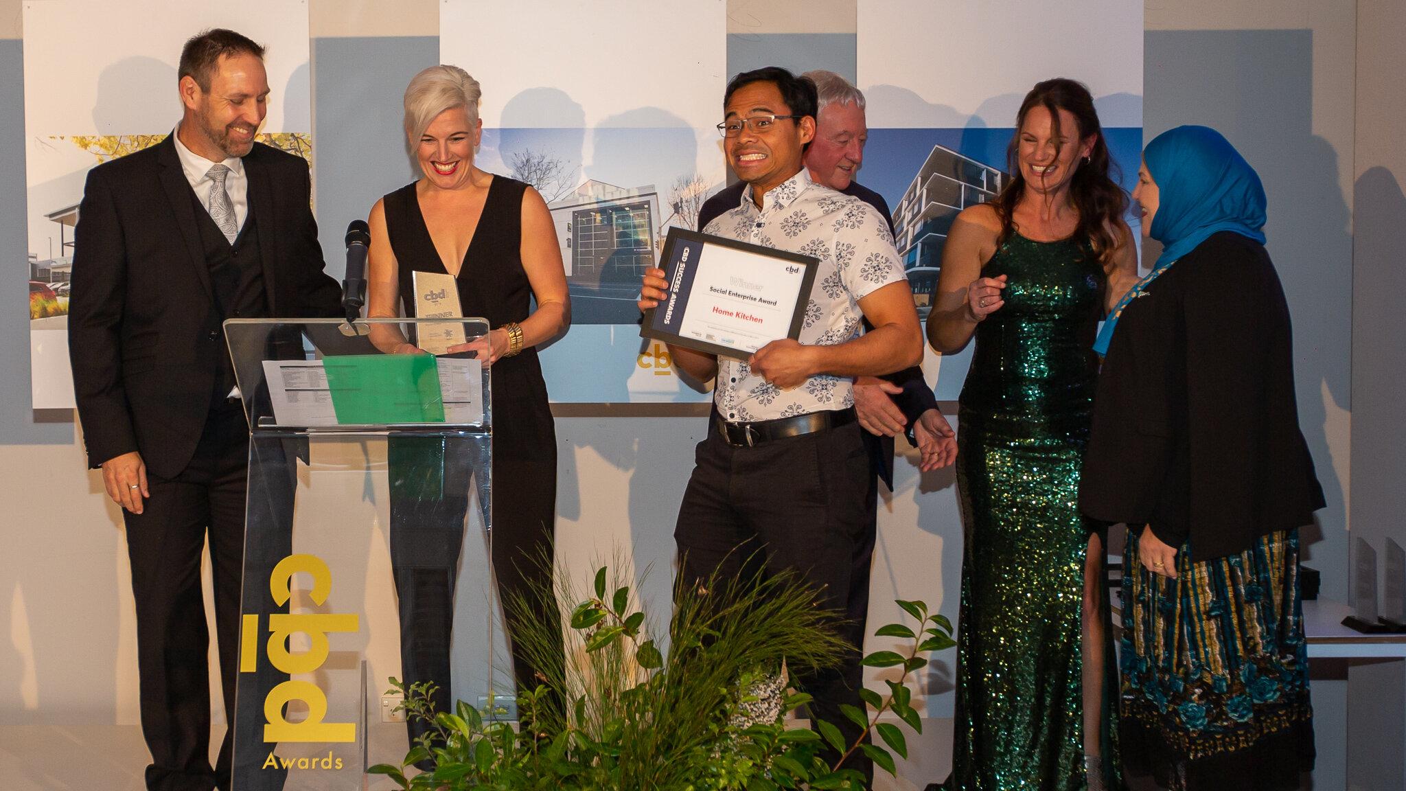 Social Enterprise Award! - Congratulations to the Home Kitchen team for taking out the Social Enterprise Award last night at the #hamiltoncbdawards. Delighted for our wonderful chefs, front of house team, volunteers and trustees who bring the magic to all that is Home Kitchen! Pictured, Tania Jones (Founder), Samir Harith (Trustee), Maysa Sheik Al Ard (Operations Manager)Home Kitchen Team (Not Pictured): Nikbakht Danish, Taj Begum, Abu bkr Alzraiqi, Ali Alzvaiqi, Diaa Alzreikat, Frozan Aziz, Masooma Aziz, Nawahel Alzinati, Sofaida Bin Ilyas, Saboor Abdul, Umar Abdul