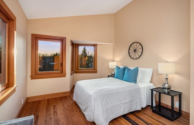 One of two spacious guest bedrooms, also with vaulted ceilings.