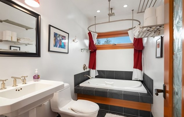 The guest bath on the upper level features a soaking tub.