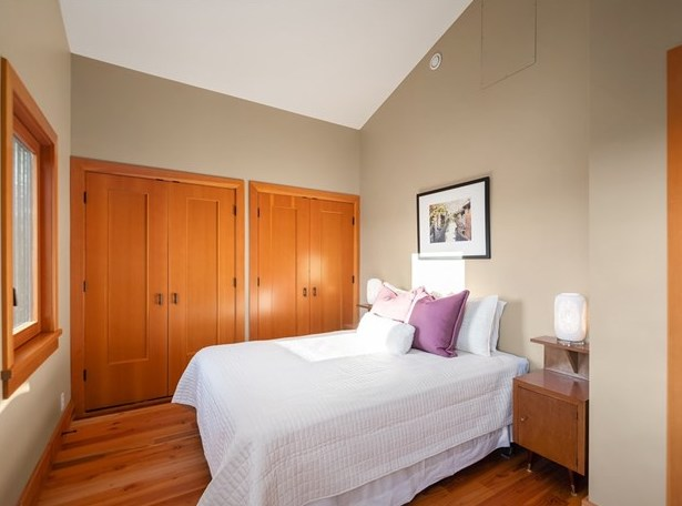 The second of two spacious guest bedrooms, also with vaulted ceilings and generous closet space.