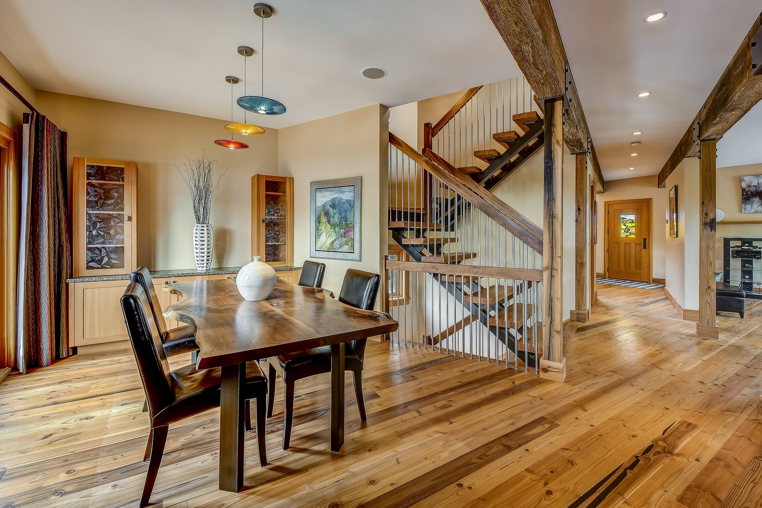 The spacious dining area features custom built ins designed by a local Ballard craftsman.