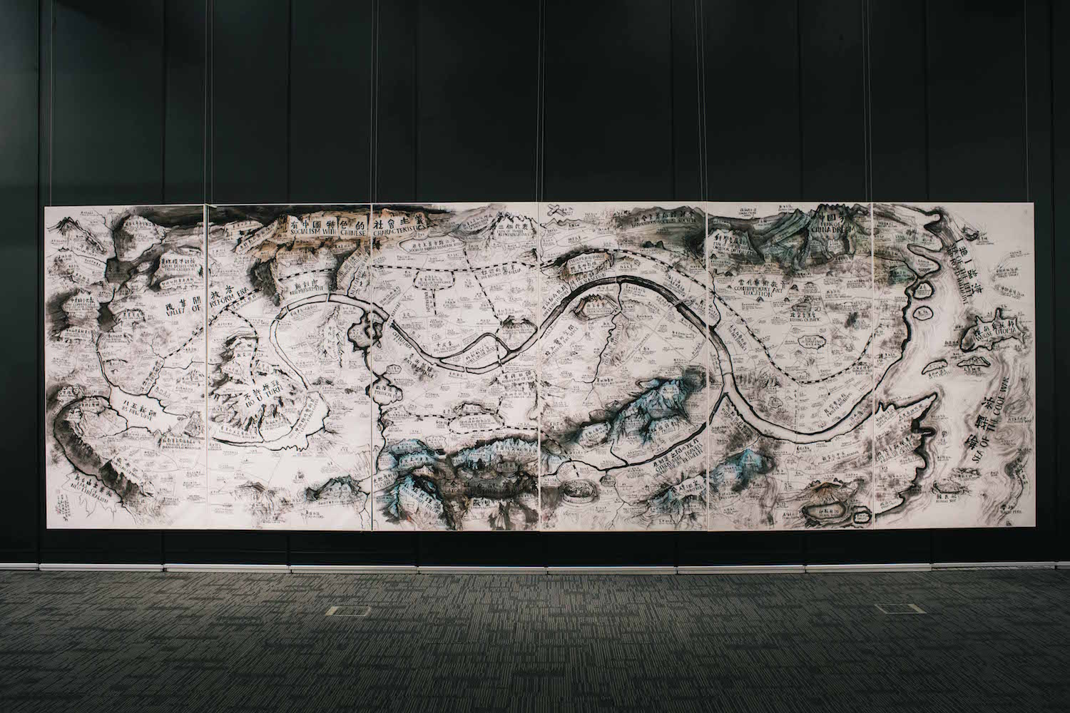 Installation view of Qiu Zhijie, 'Map of Art and China after 1989: Theatre of the World', 2017, colour print, 240 x 720cm. Image courtesy of Parkview Museum Singapore.