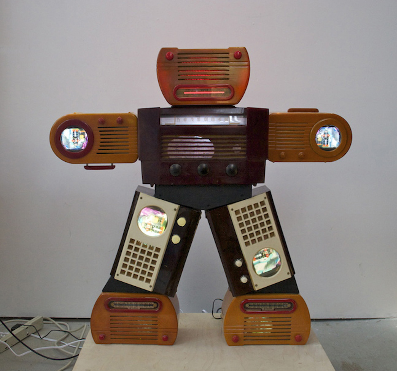 Nam June Paik, 'Bakelite Robot', 2002, one-channel video installation with 4 14.2cm LCD monitors, 2 10.2cm LCD colour monitors, coloured electric lights, 92 x 92 x 19.7cm. Image courtesy of Gagosian Gallery.