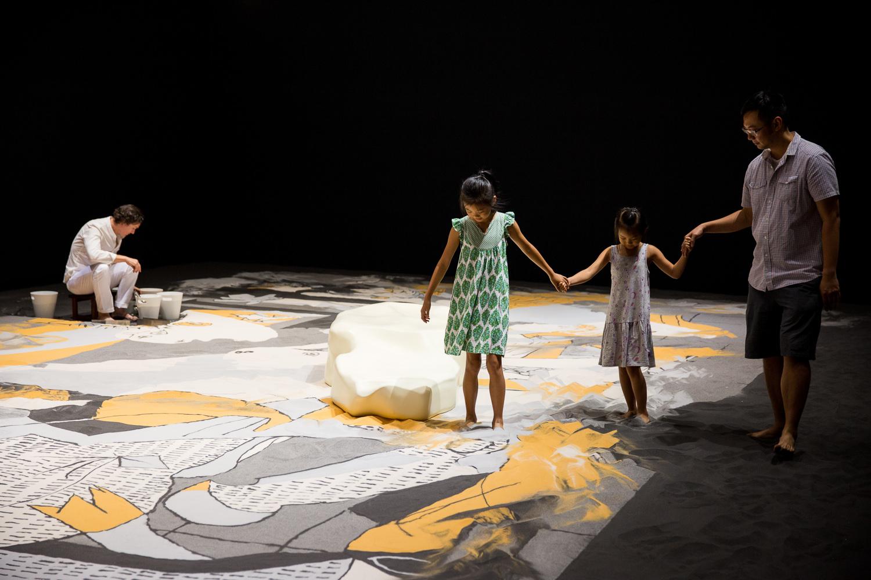 Lee Mingwei, 'Guernica in Sand', 2006/2015, mixed media interactive installation, sand, wooden island, lighting, 1399 x 643 cm. Installation view: 'Lee Mingwei and His Relations', Taipei Fine Arts Museum, Taipei, 2015. Image courtesy of Taipei Fine Arts Museum.