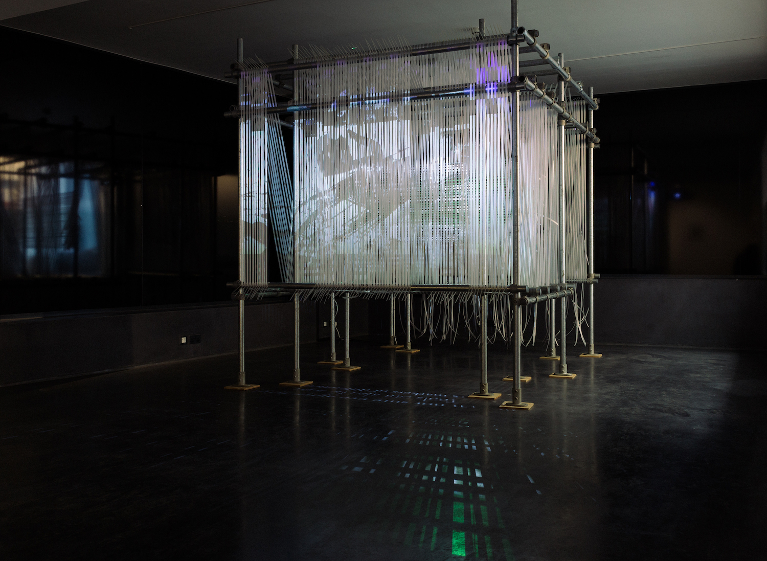 Erika Tan, 'The 'Forgotten' Weaver', 2017-2019, 2-channel video projection, strapping screen and metal support structure, 275cm x 302cm. Image courtesy of Wei-Ling Contemporary.
