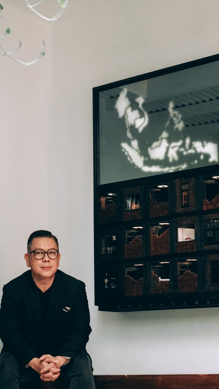 Leo Silitonga, Founder and Fair Director, Art Moments, with a work by Indonesian artist Aditya Novali. Image courtesy of Art Moments.