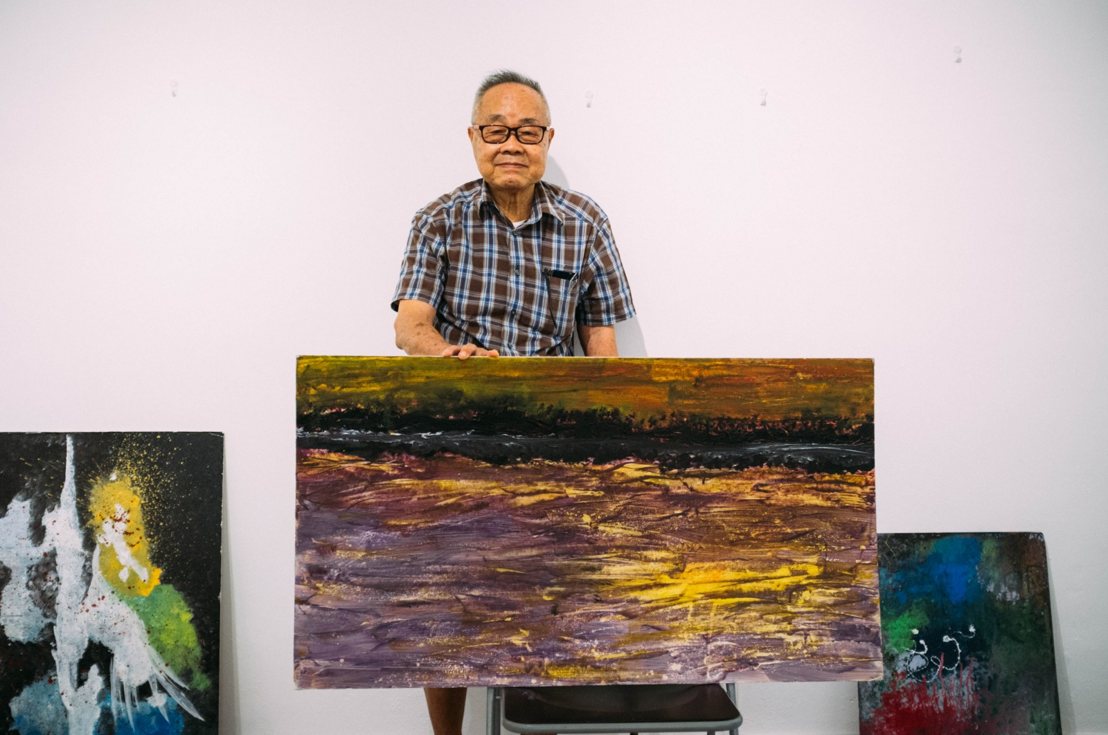 Mr. Johnny Wong with his foam board paintings. Image courtesy of Mothership.SG