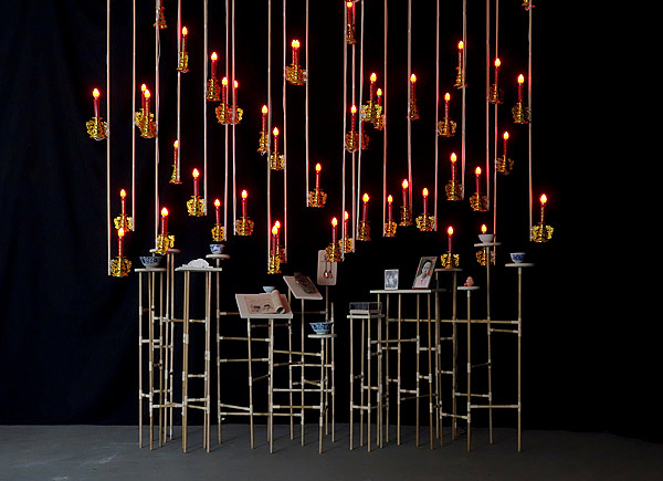 FX Harsono, 'Gazing on collective memory', 2016, wood, found objects, books, ceramic bowls, wooden butter mould, wooden cookie mould, metal spoons, 3D digital prints, framed photographs and electric candle lights. Image courtesy of National Gallery of Australia.