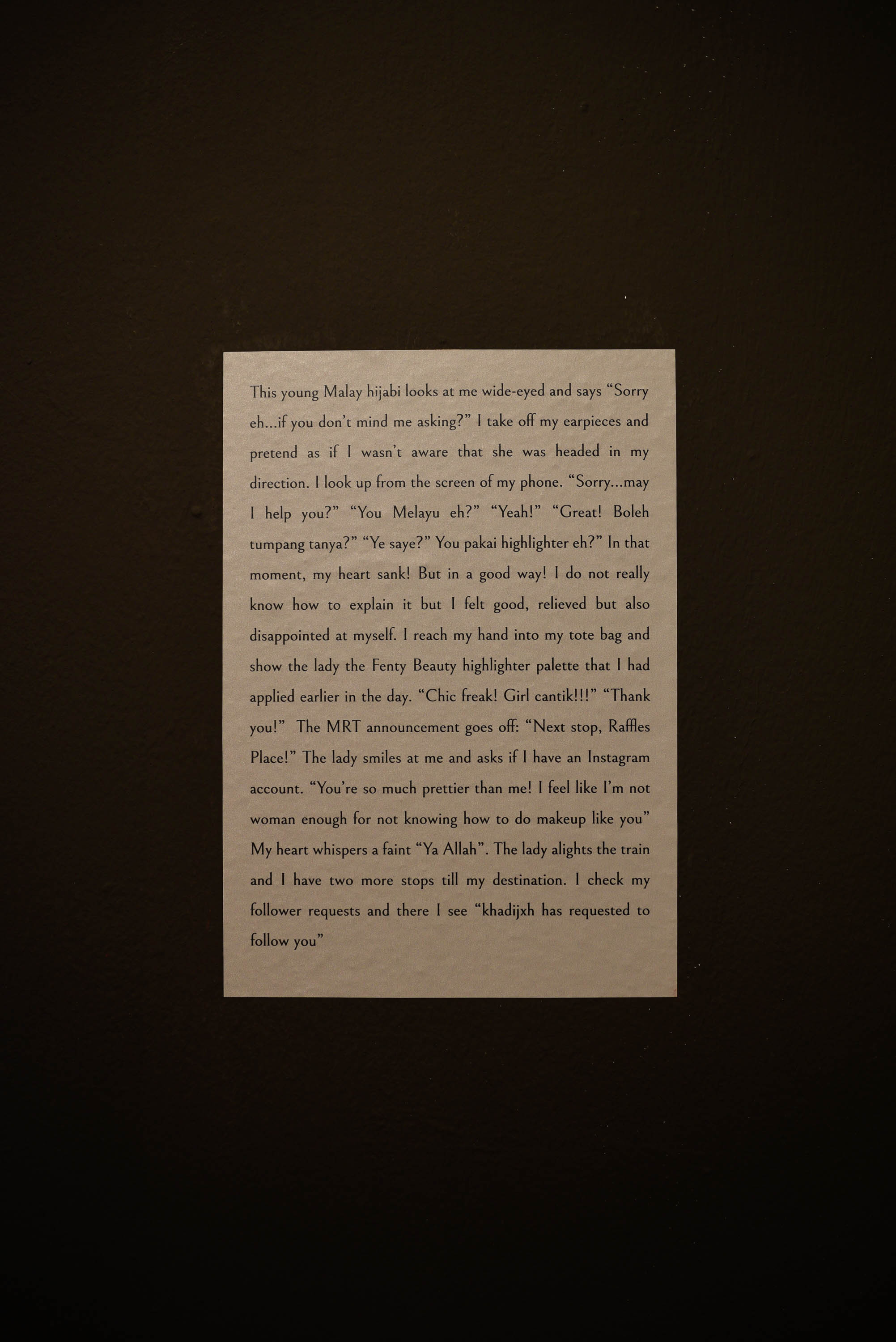 One of the short narrative passages found around the exhibition, this anecdote is from Norah Lea. Photo by Ivan Ong.