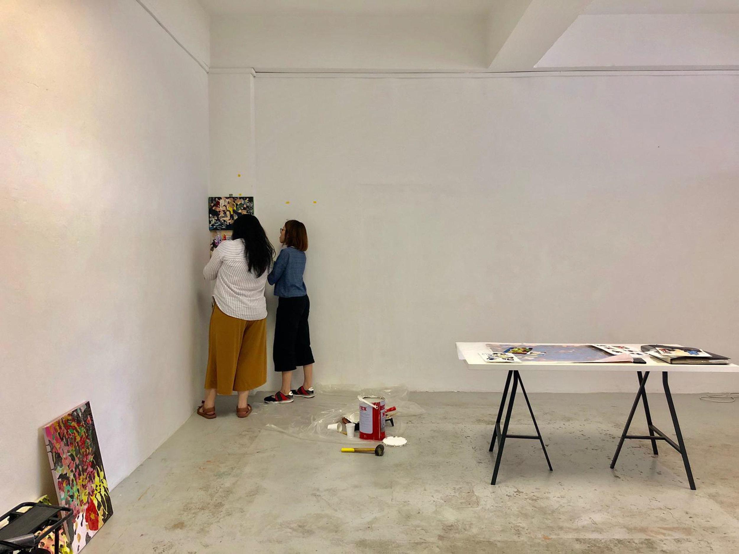 A behind-the-scenes look at Samantha and Jodi installing 'Section #7', at Peninsular. Image courtesy of Peninsular.