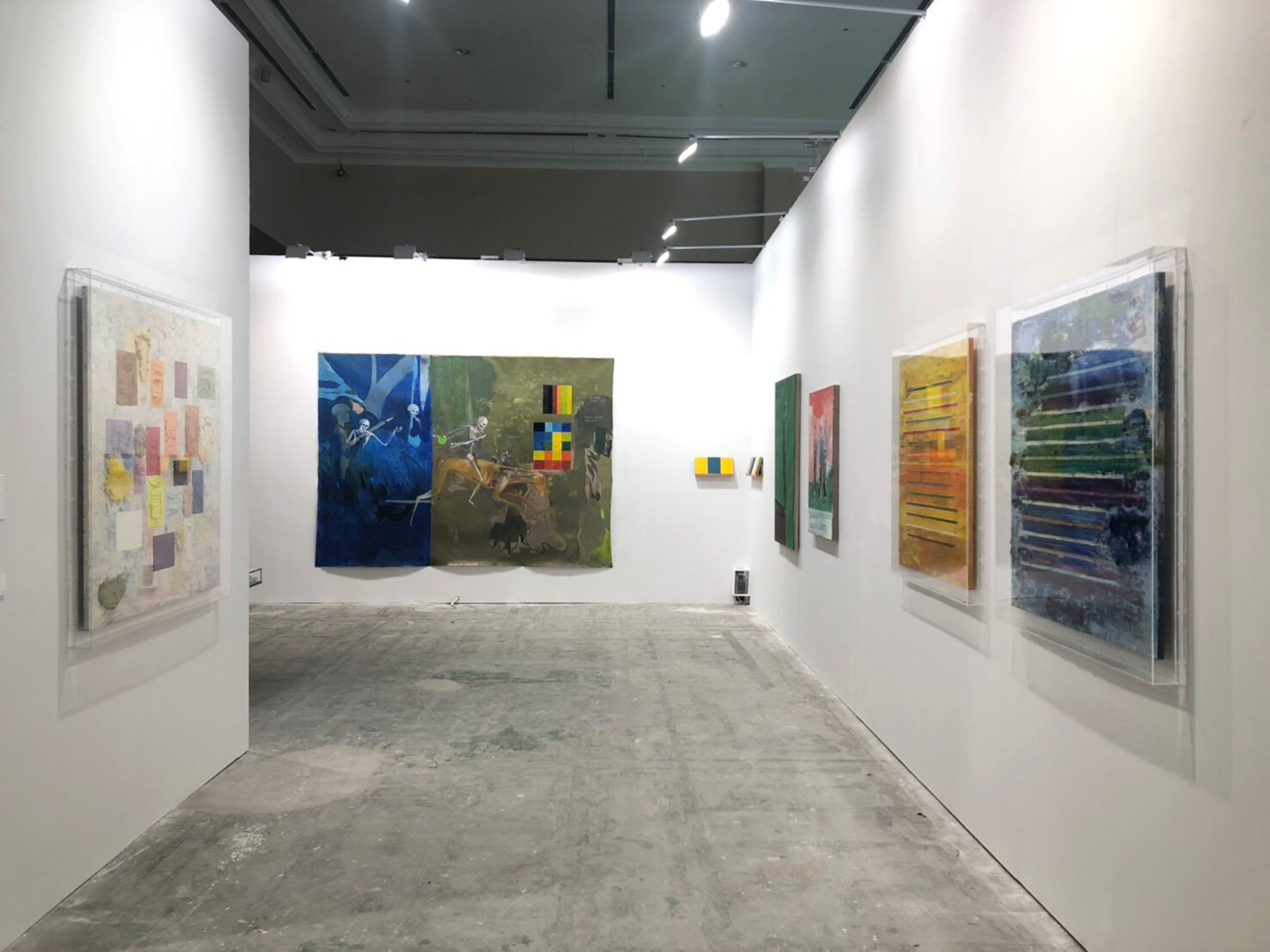 TKG+ booth, featuring works by Mit Jai Inn and Sawangwongse Yawnghwe. Image courtesy of TKG+.