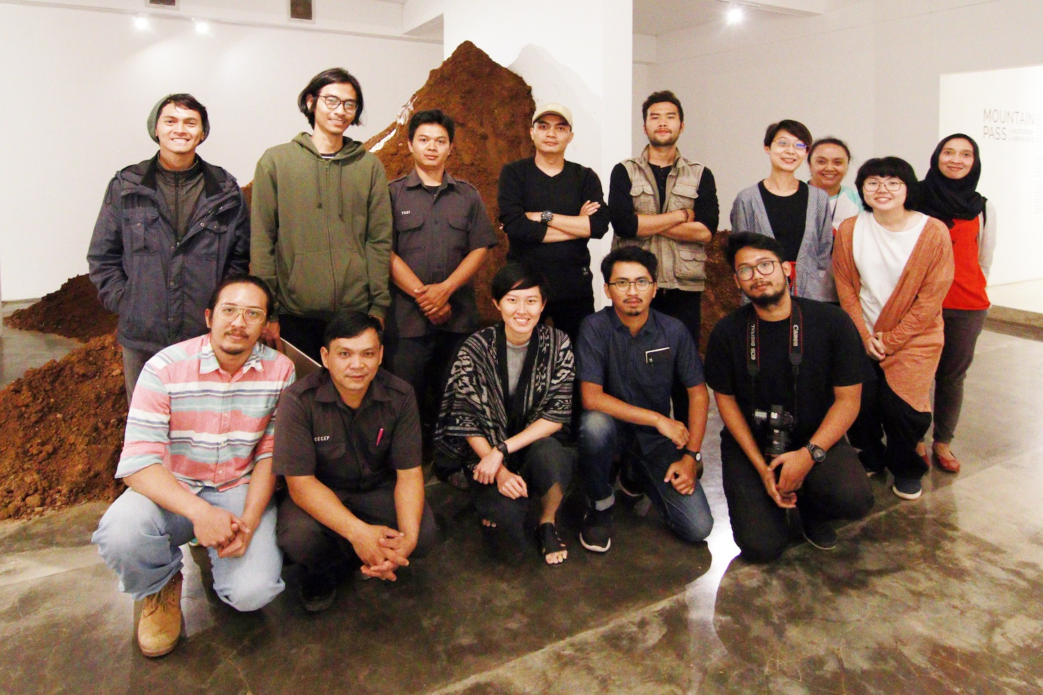 "The artist and the exhibition team of ""Mountain Pass: Negotiating Ambivalence"" in Bandung. Photograph by Adi Rahmatullah Image courtesy of Selasar Sunaryo Art Space and Mizuma Gallery."