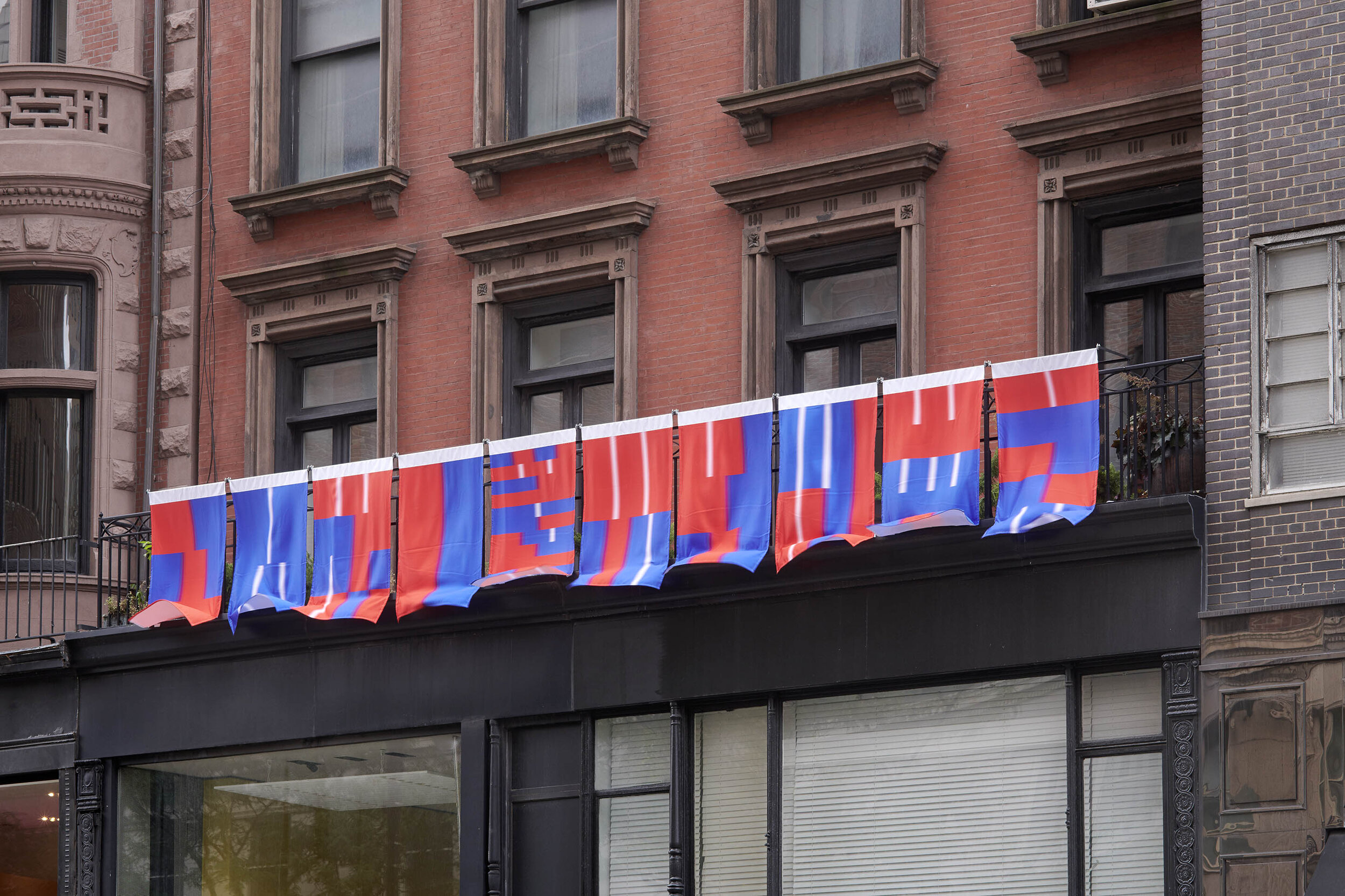 Photo documentation of outdoor installation at Helwaser Gallery, New York, showing 'Art is only a continuation of war by other means (flags)', 2019. Image courtesy of Helwaser Gallery. © Boedi Widjaja. Photography by Phoebe d'Heurle.