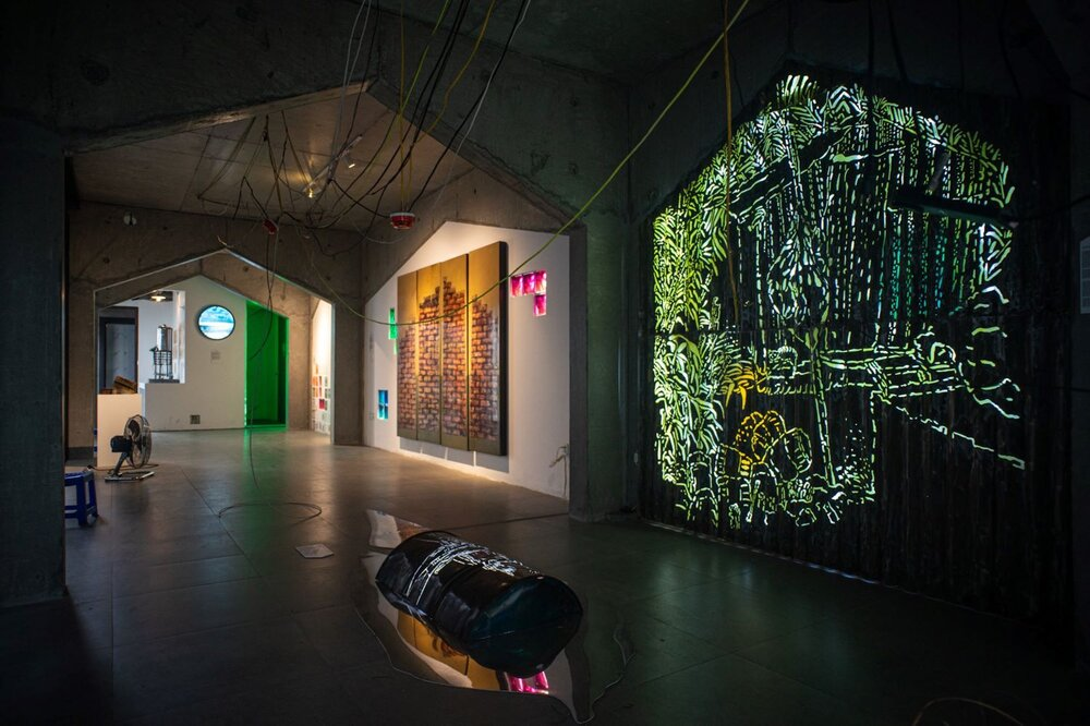 Nguyễn Oanh Phi Phi's 'The Great Wall' (left) and Lê Đăng Ninh's 'The Dark House' (right), exhibition installation view. Image courtesy of the artist-curator Nguyến Thế Sơn.