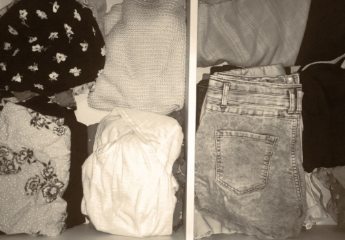 My summer clothes in drawers organised under my bed