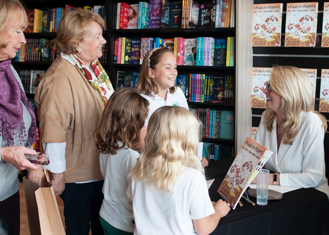 Excited children waiting for their signed copies :)
