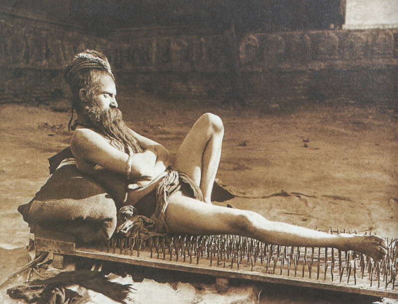 Benares, British India c. 1907 Yogi on bed of nails. by Herbert Ponting