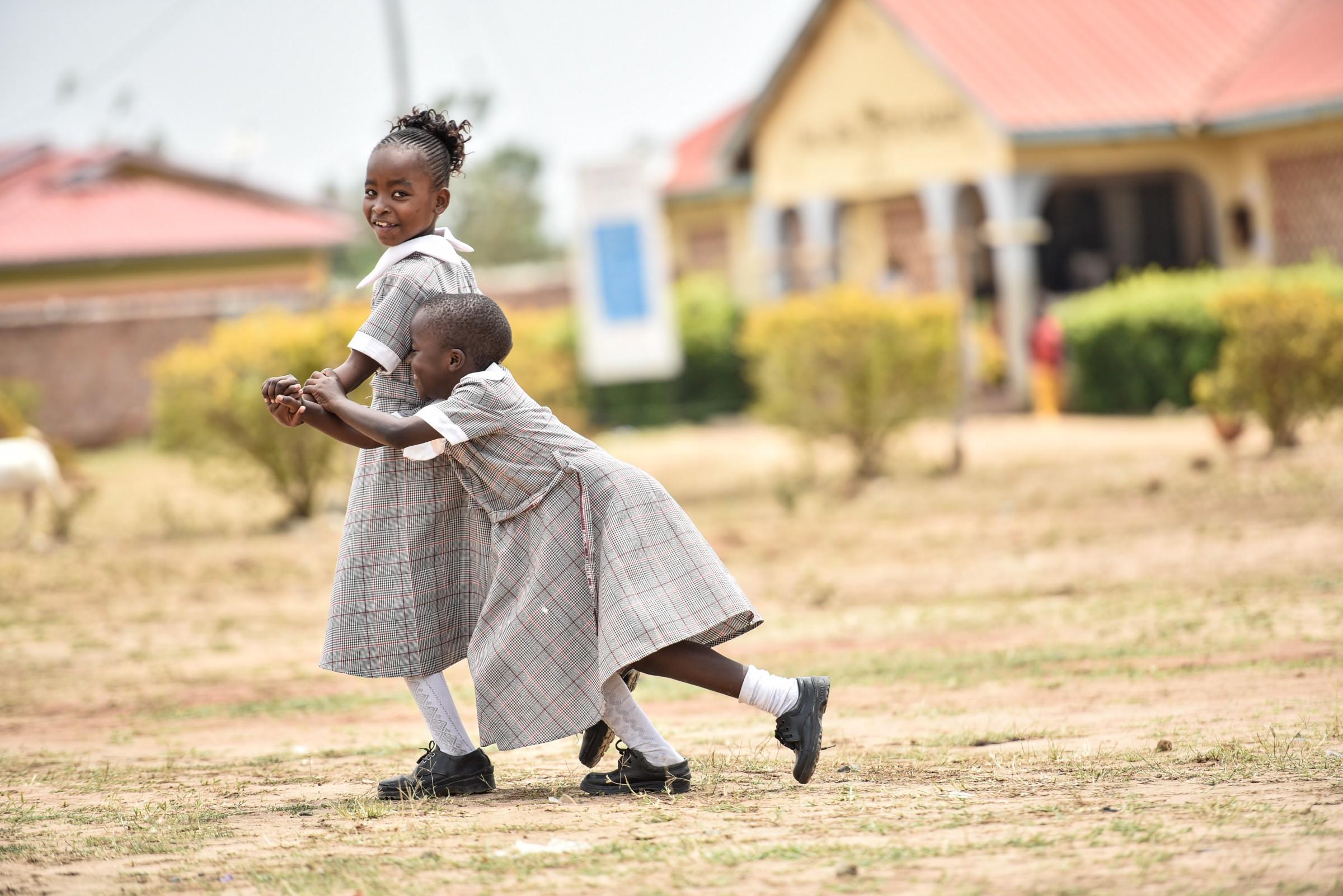 Girls playing in Malaba, a cross-border community between Uganda and Kenya