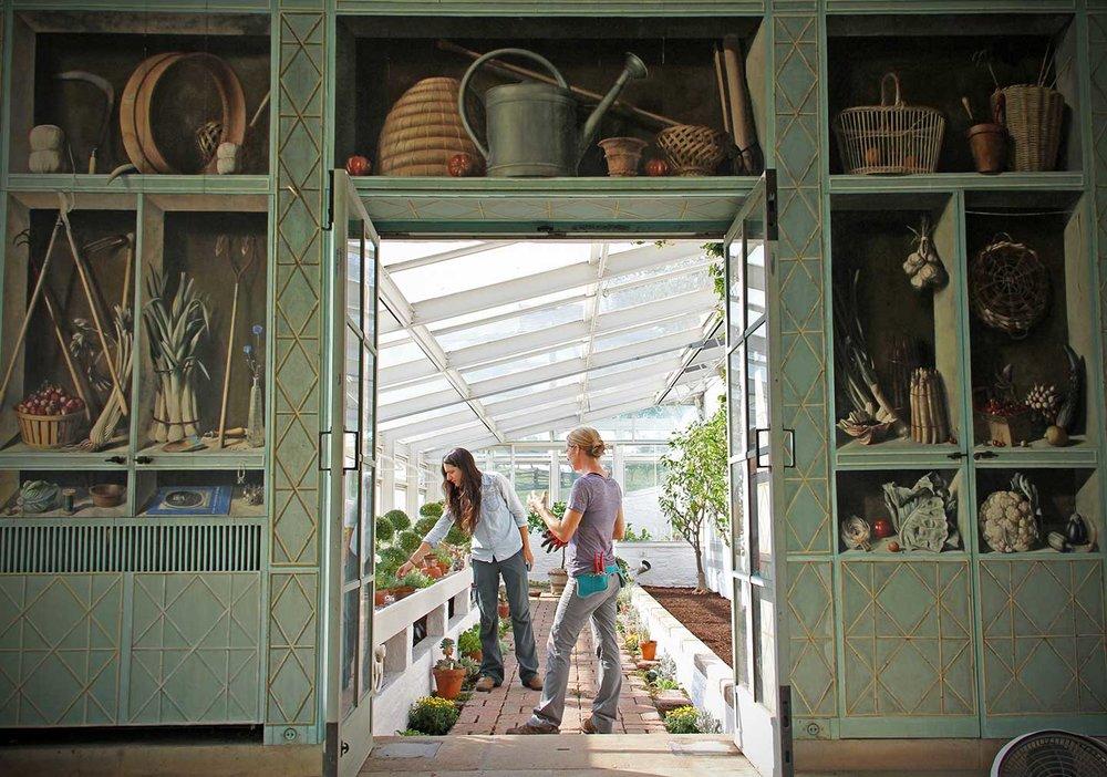 View of an arcade at Oak Spring Garden greenhouse. The trompe l'oeil scenes were painted byFrench artist Fernand Renard.  © Oak Spring Garden Foundation
