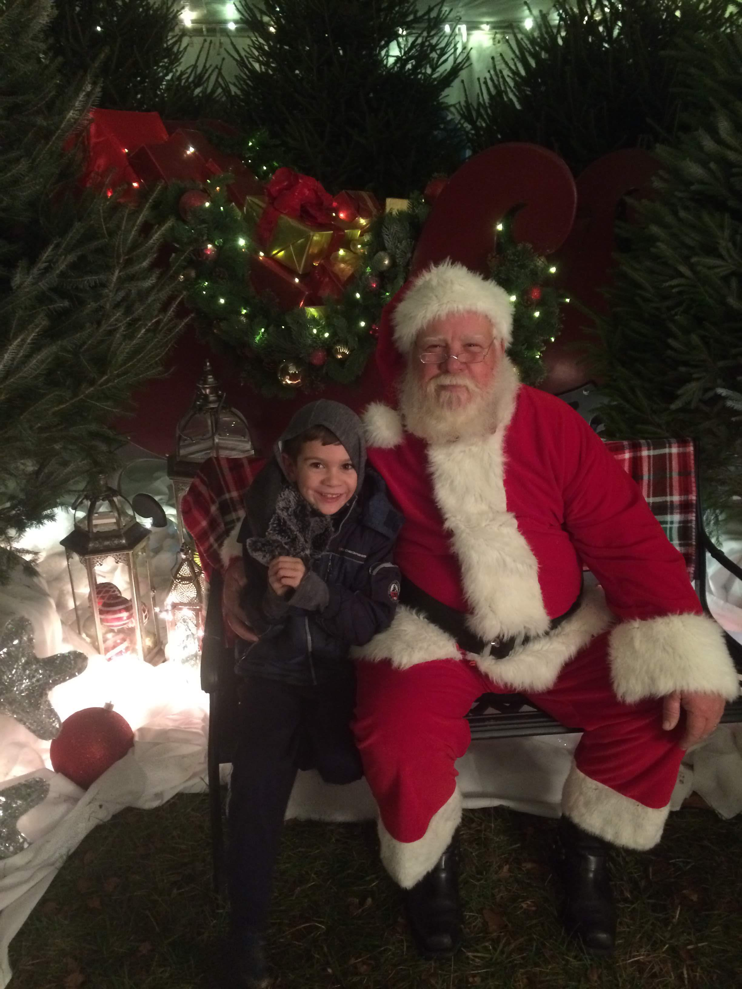 - Max with Santa at the Winter Wonderland in our neighborhood.