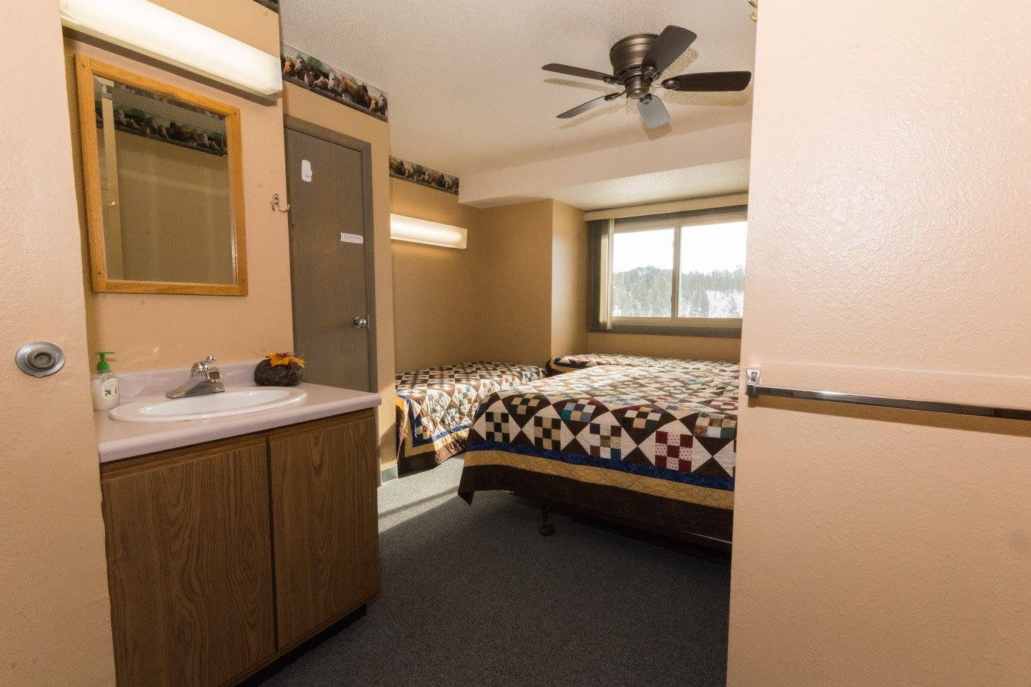 Our rooms include a sink and shared bathroom.