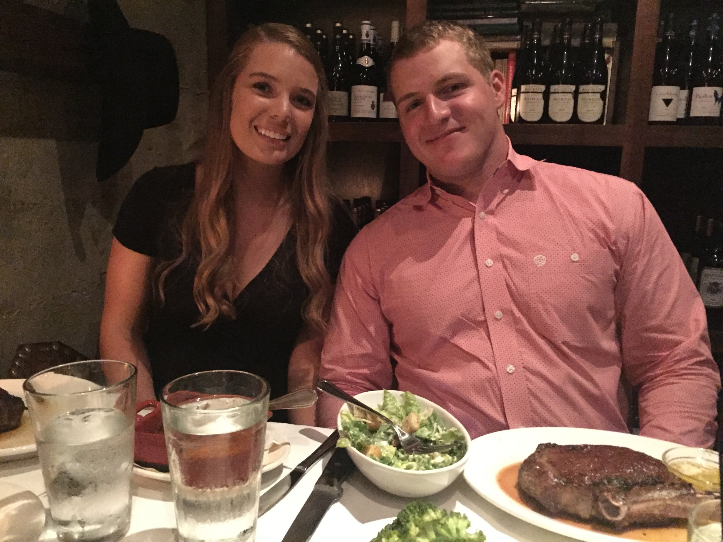 """With his girl, Maddie, and the """"cowboy steak"""" I got him for his 21st birthday."""