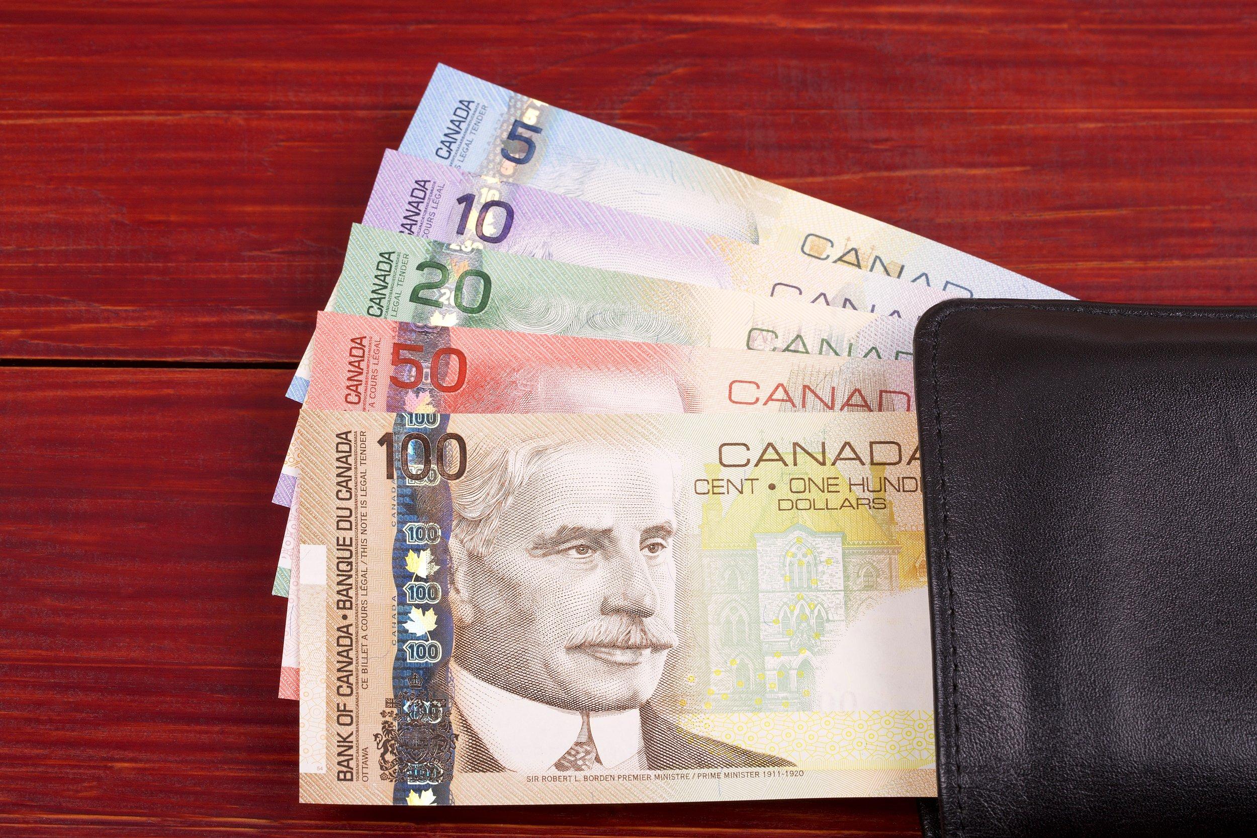 canadian-money-in-the-black-wallet-3YADE9V.jpg