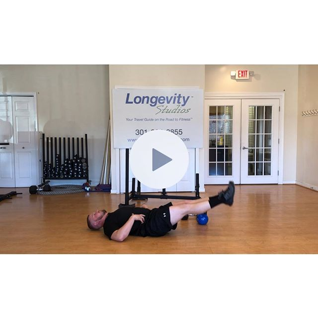 As we are in the full celbration of the holidays now, we are at Day 9 of our 12 Days, We continue to focus on the core. The Day 9 new exercise is Supine Leg Lifts and you are doing 9 reps.  This exercise is great for those lower abdominal muscles that can always use some help. The object is to raise and lower the legs in a controlled fashion. The biggest aspect to focus on is the postion of the low back (lumbar spine). The spine should remain relatively still as the legs move. If the back is arching and flattening, the load of the leg is too much. You can modify the exercise to counter this just bending the knees. If the exercise feels too eazy, you can hold an object between the knees or ankles.  Again, this might be a time to be more creative. If you using bodyweight, you can wear your most festive holiday socks. This will allow you more Christmas spirit and motivation every time you lift your legs. Use a newly wrapped gift (non-fagile of course) to put between your knees to do the exercise. Buy yourself a medicine ball for Christmas, put it between your ankles, and leg lift away. This will also allow you to use it later for other exercises!  The other exercise techniques and modifications are on the posts for the day that they are introduced into the 12 Days of FitMas program. Also don't forget, you cam be doing more than one round of this joyous workout!  Day 9 A push-up with a freaking burpee 2 prowler shoves 3 body squats  4 dumbbell curls  5 MORE BURPEES 6 tricep push-ups  7 bells a swinging (KB Swings) 8 windshield wipers 9 legs a lifting (supine leg lifts/lowering)  As you watch Neil, you can see how serious he is starting to look and how his nose is starting to get a little red ... like Rudolph!!! To see the full video, click the link in the bio. #longevitystudios #12daysoffitmas #holidayfitness