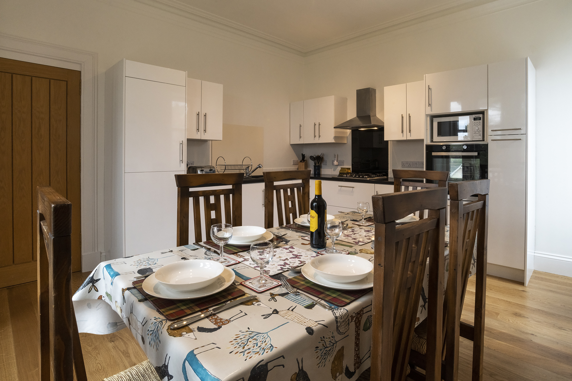 Kitchen/diner - A new kitchen diner with dishwasher, gas hob, electric oven and microwave. Fully stocked with everything you need for a self catering holiday.