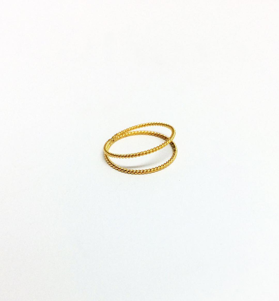 Made from old gold jewellery and transformed into a minimal and elegant ring