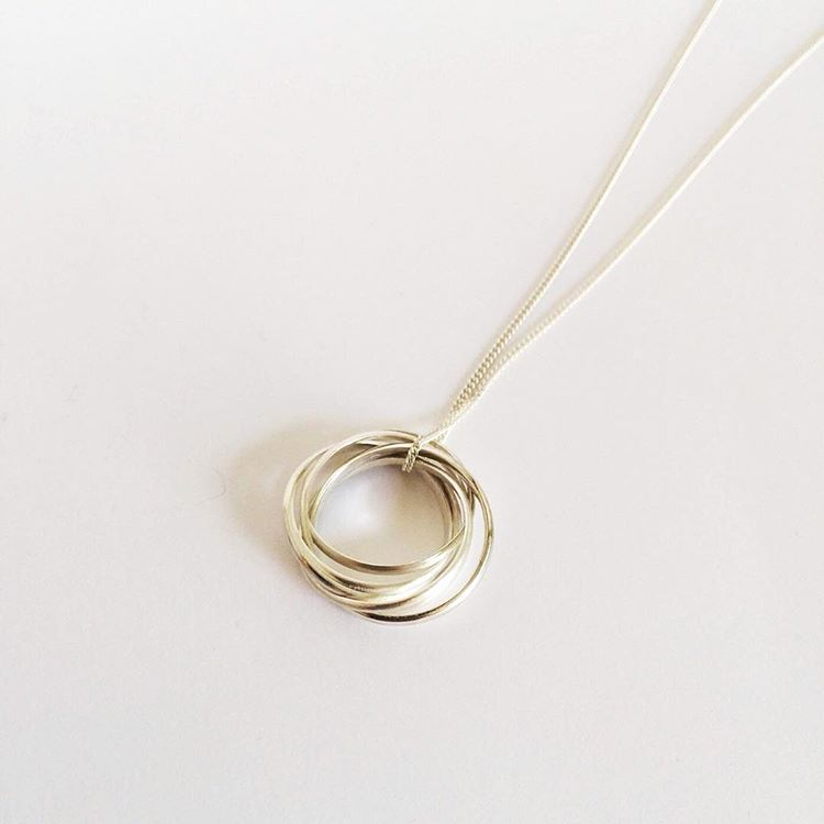 A sterling silver necklace that is also a ring.