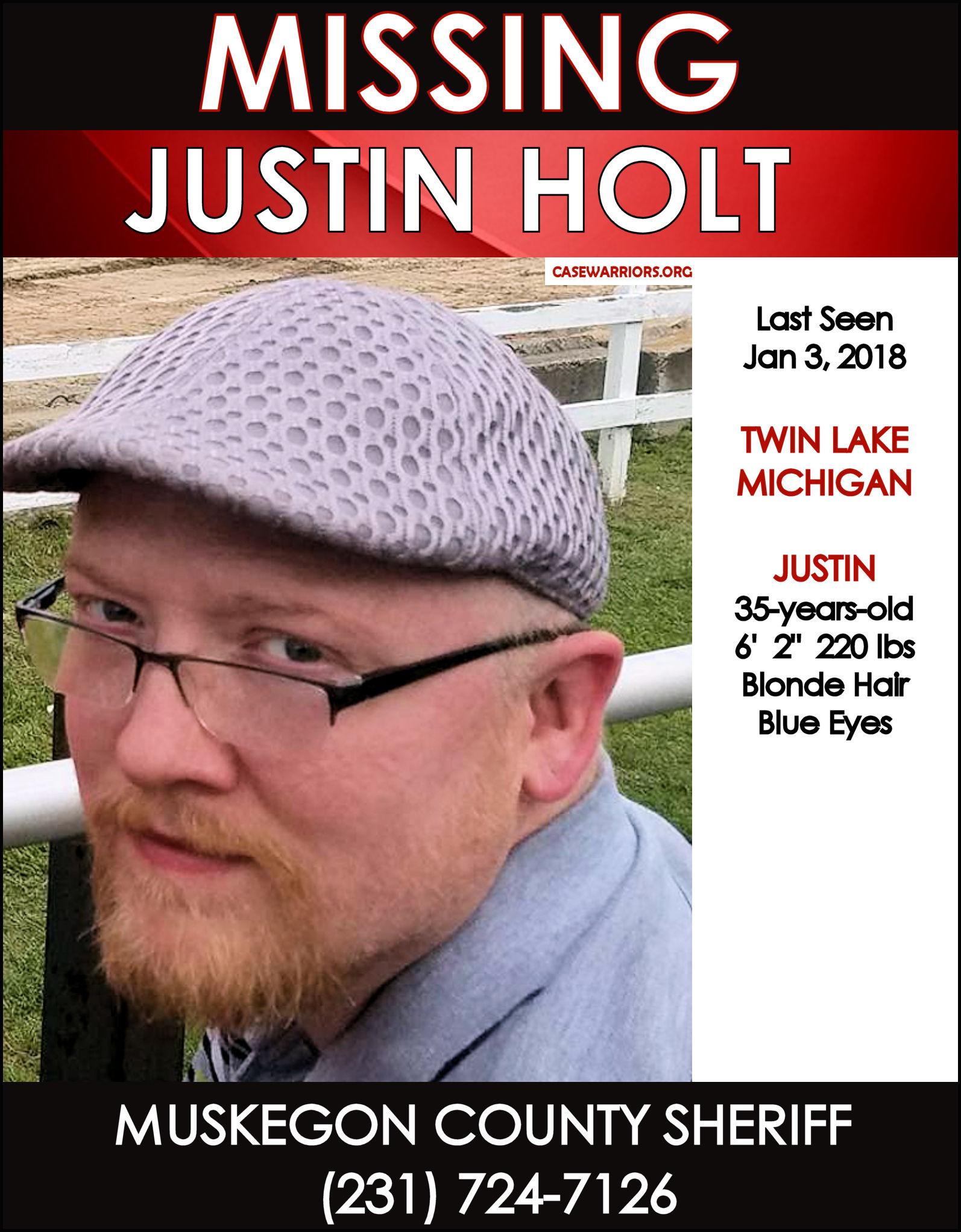 JUSTIN HOLT