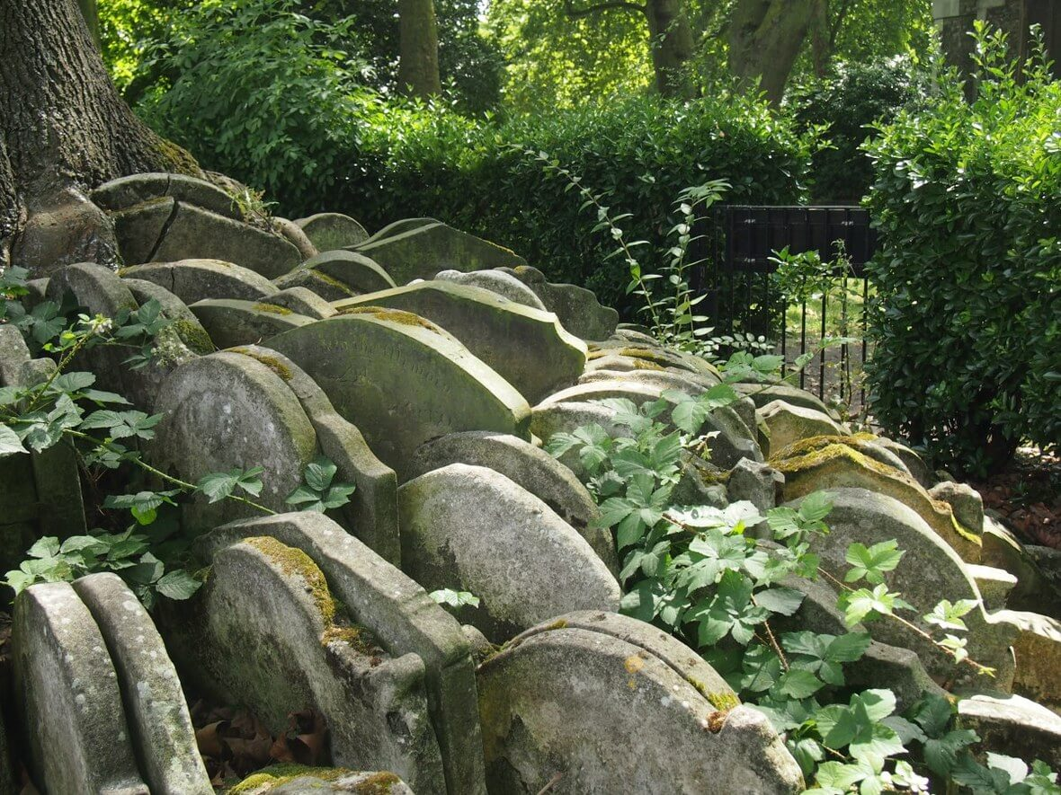 Tombstones piled up in a graveyard