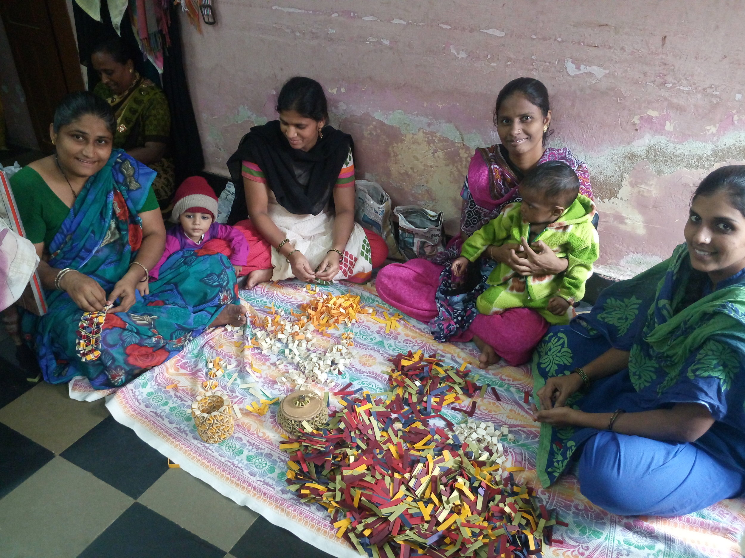 """A JOINT VENTURE - 4EvrCarma is a joint venture with WE Recycleout of Hyderabad, India to produce an elegant line of accessories upcycled from waste materials created by using dozens of women from the poorest regions (""""slums"""")… transforming lives and communities."""