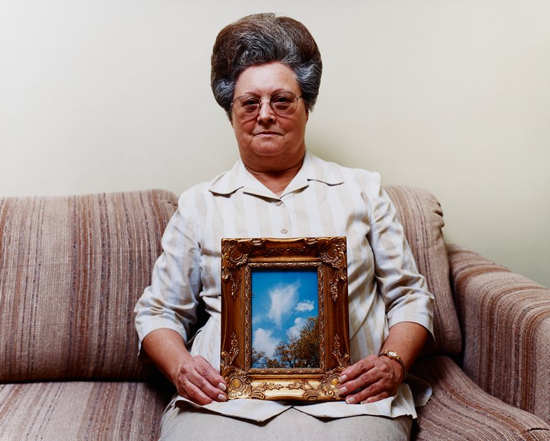 Bonnie (with Photograph of an Angel), Port Gibson Mississippi  (2002)  Alec Soth, American (b. 1969)  Chromogenic print  Lent by the Minneapolis Institute of Art, The Alfred and Ingrid Lenz Harrison Fund