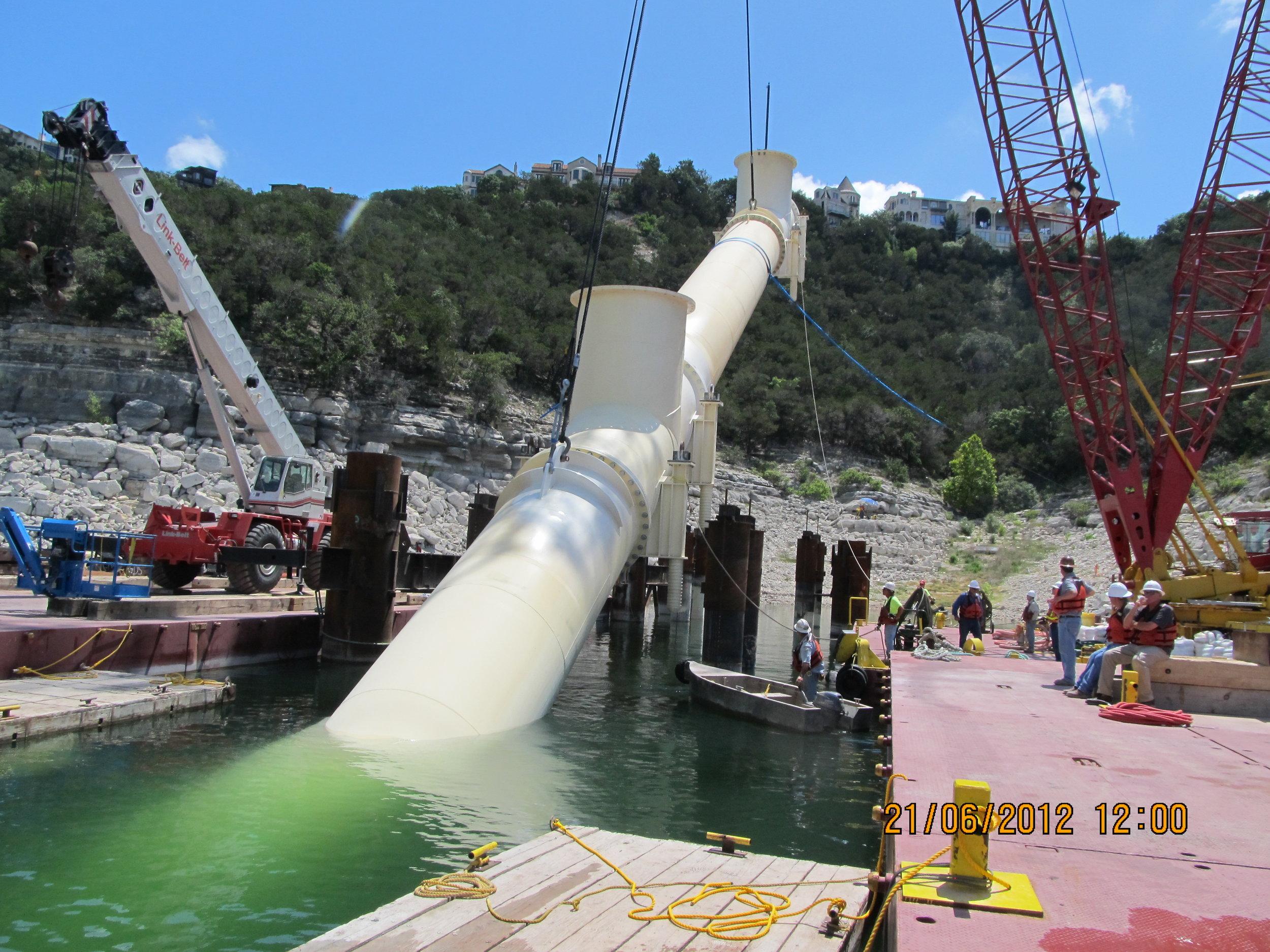 TX Professional Geoscience Lowering Intake Pipe.JPG