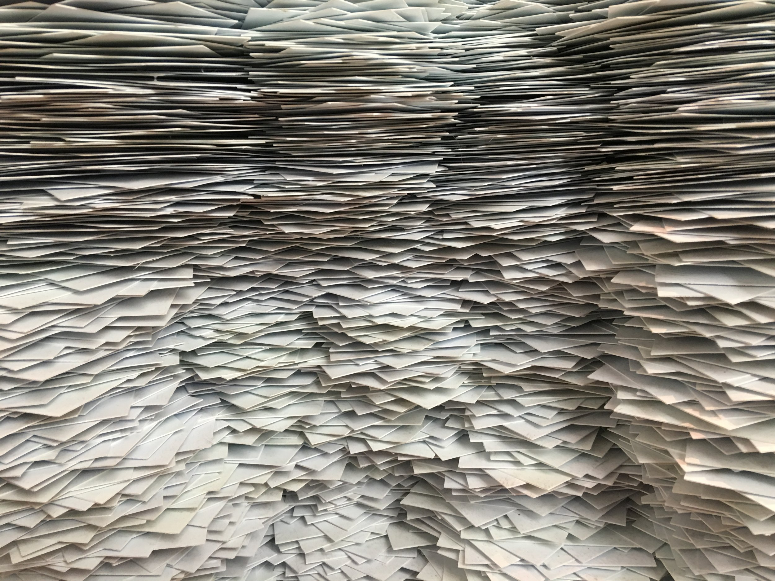An overwhelming stack of paperwork - similar to what it feels like when getting a mortgage.