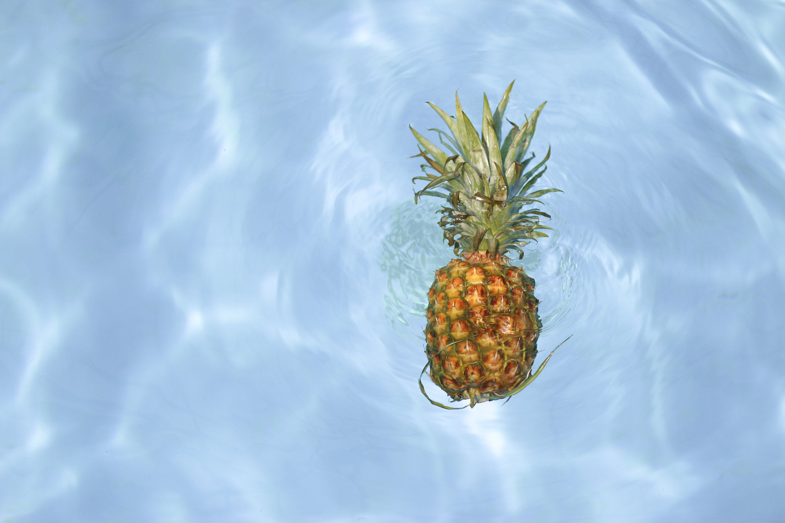 Floating pineapple. Symbol of welcoming.