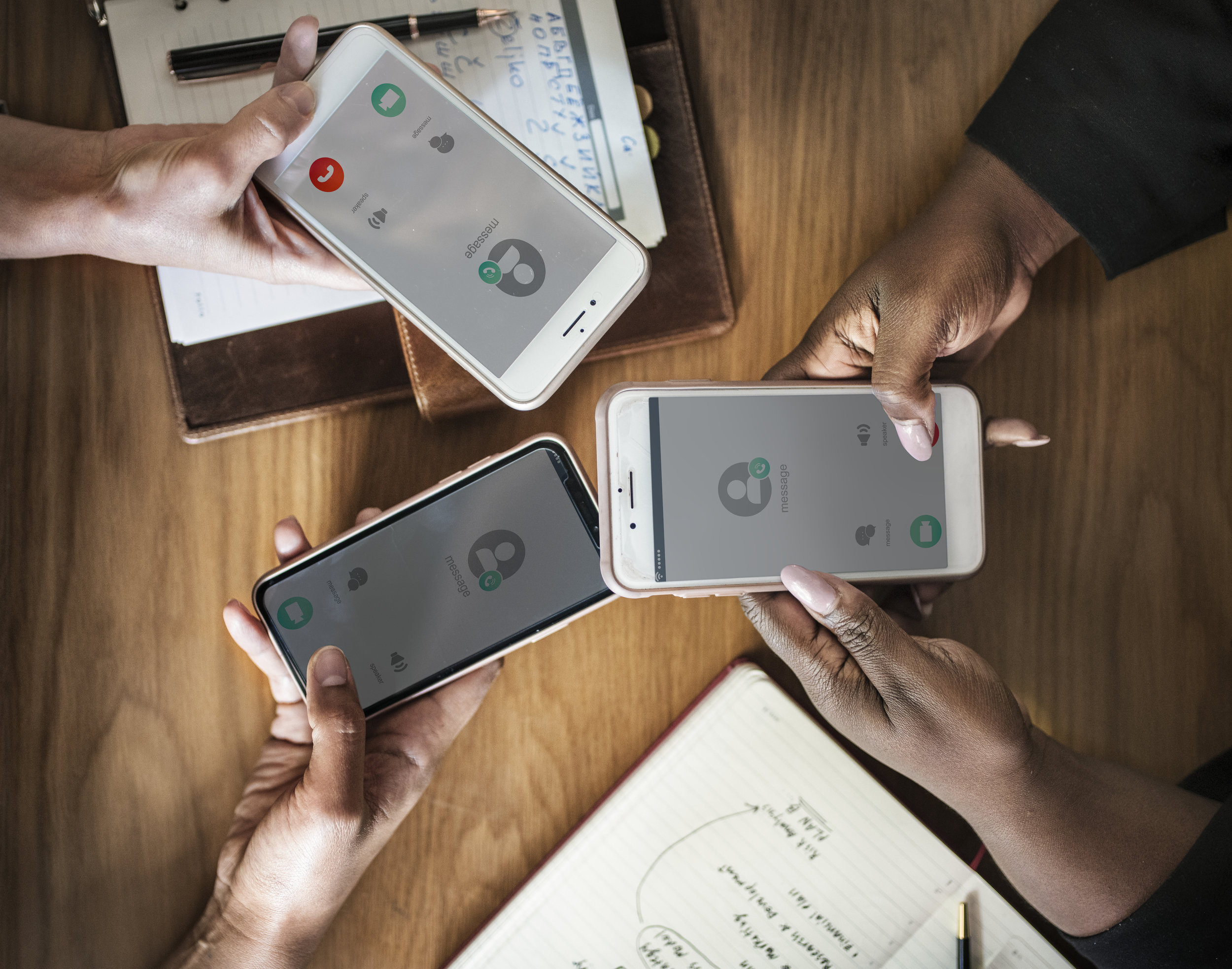 Three people holding out their cell phones and adding each other to contact list. Could be the start of their home buying process!
