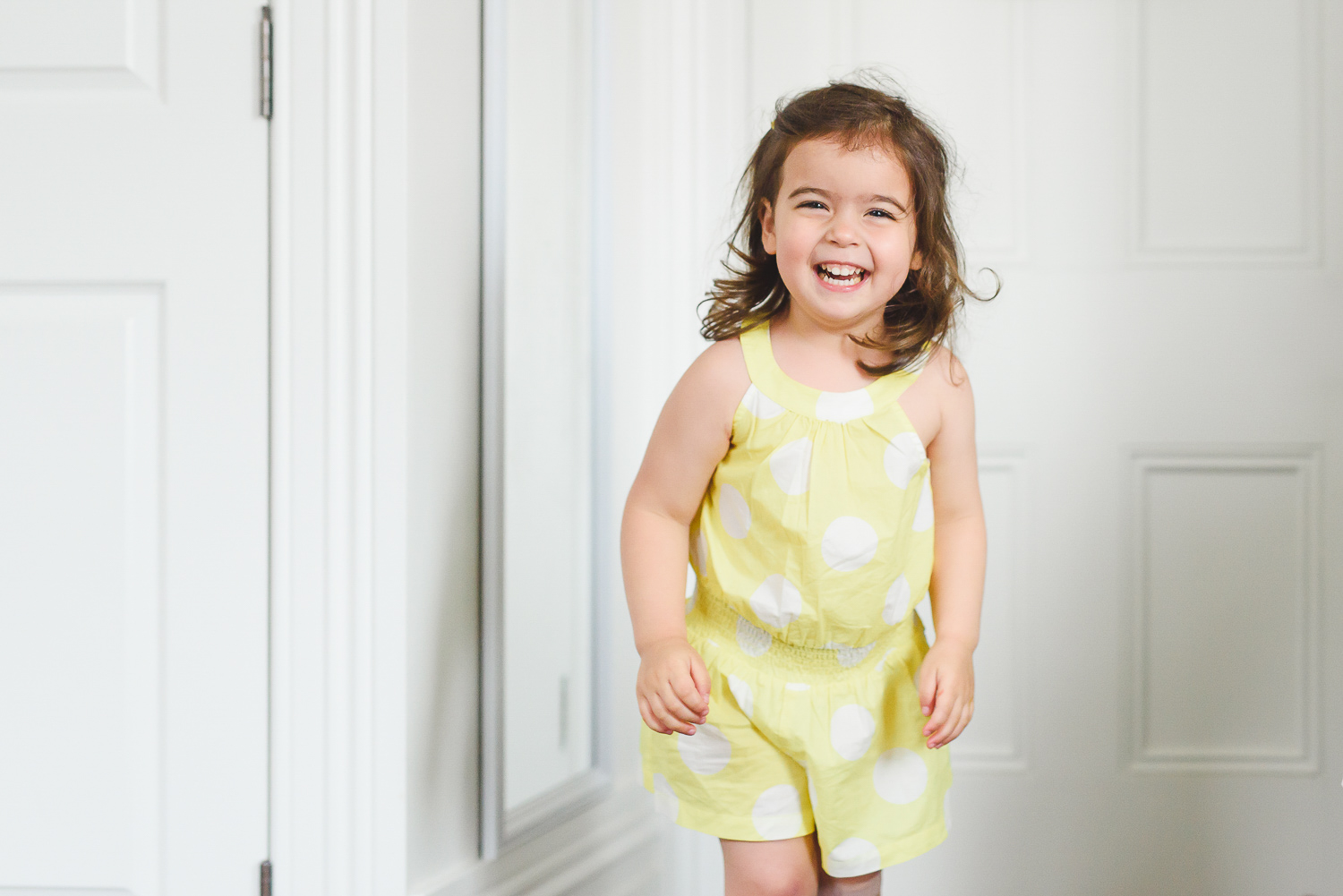 happy child in lifestyle family photo session at home in Parnell by Auckland family photographer Sarah Clayton