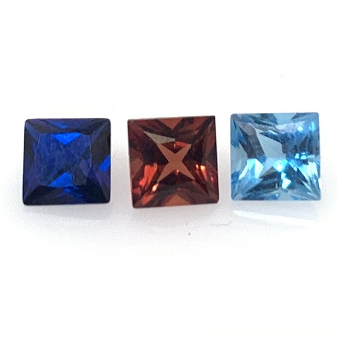Left to Right: Lab Created Blue Sapphire, Garnet, and Blue Topaz