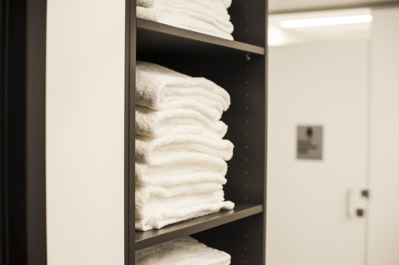 Close up of towel storage at 8 exhibition street end of trip