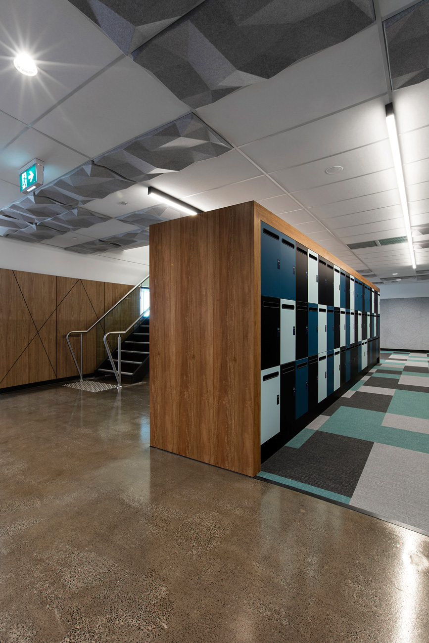 Lockers with spotted gum timber veneer shroud