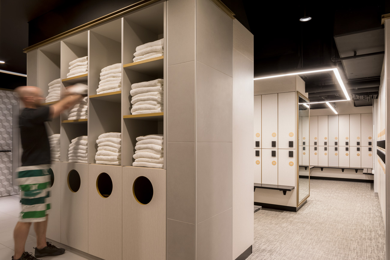 Man using towel storage in an end of trip