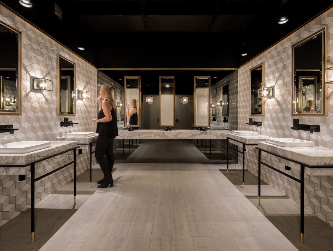 Woman at vanity in corporate office changeroom