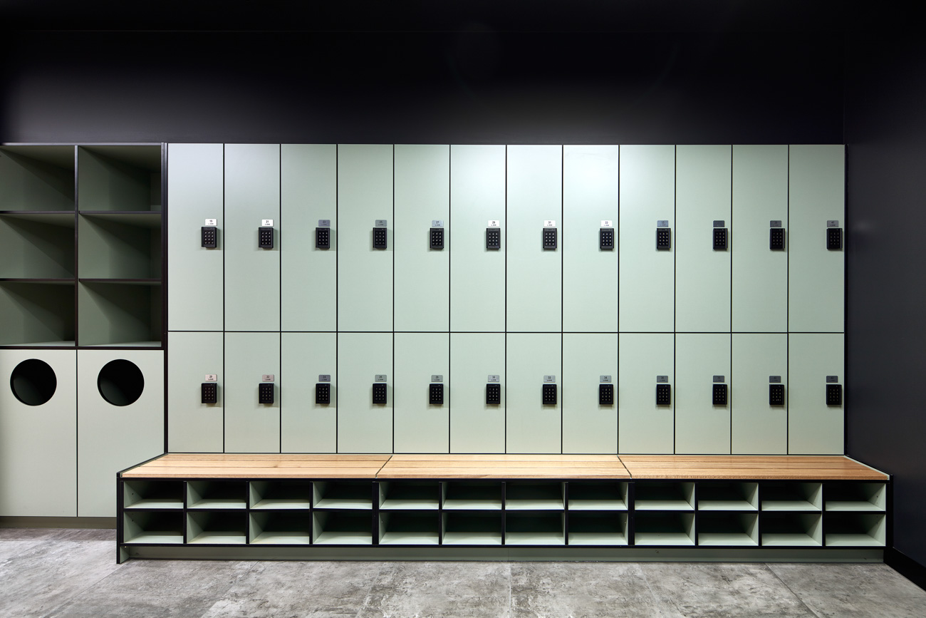 Locker bank with bench seating and shoe storage by Lockin