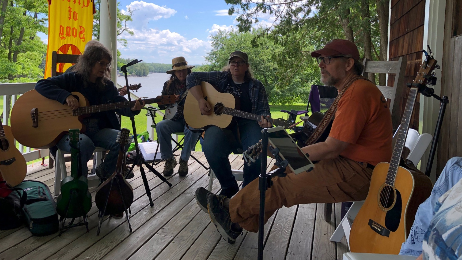 Musicians at Kingsland Bay share a song on the porch.
