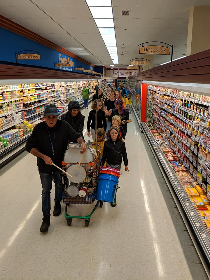 Bennington area musicians march down the meat and dairy aisle.