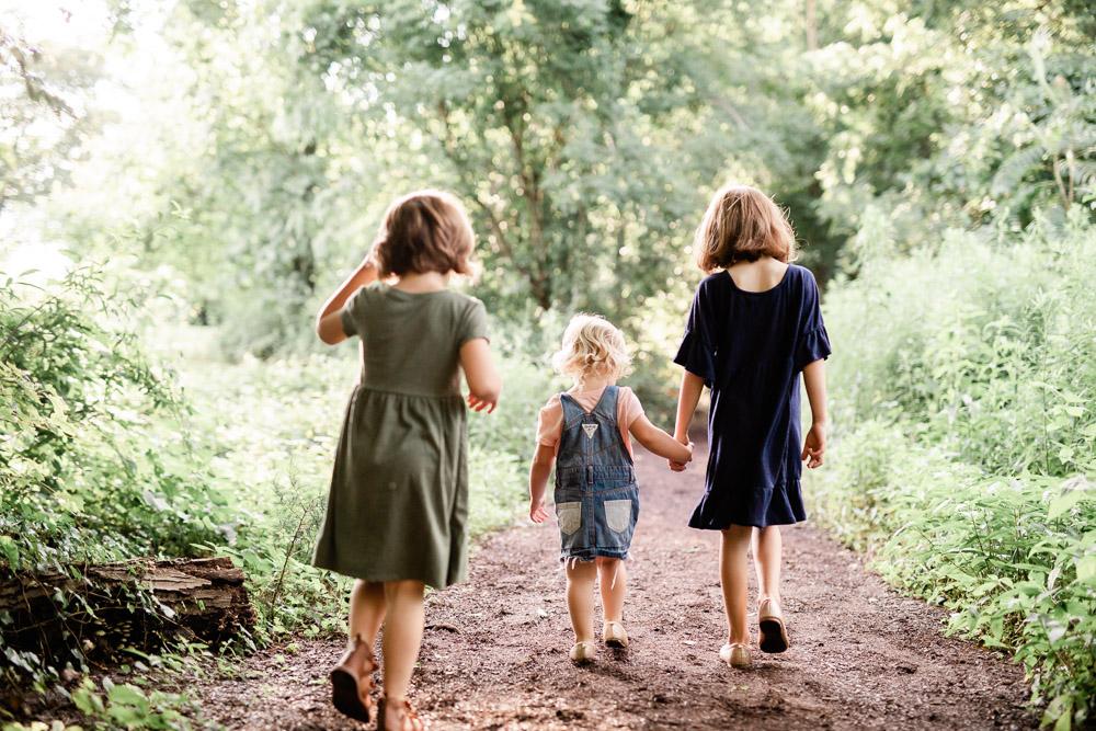 Little Girls Walking in a Forest