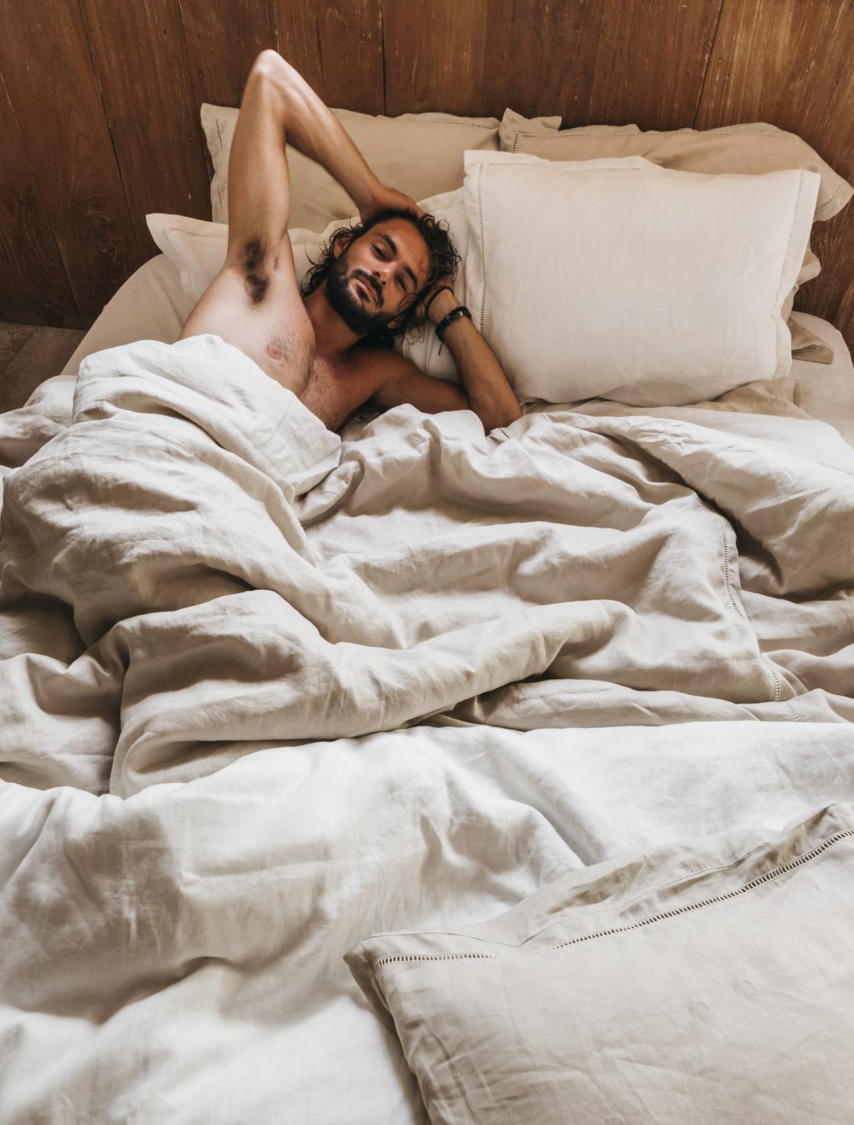 Keira-Mason-in-between-the-sheets-man-sleeping.jpg